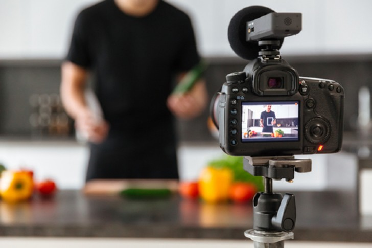social media marketing influencer filming a cookery show